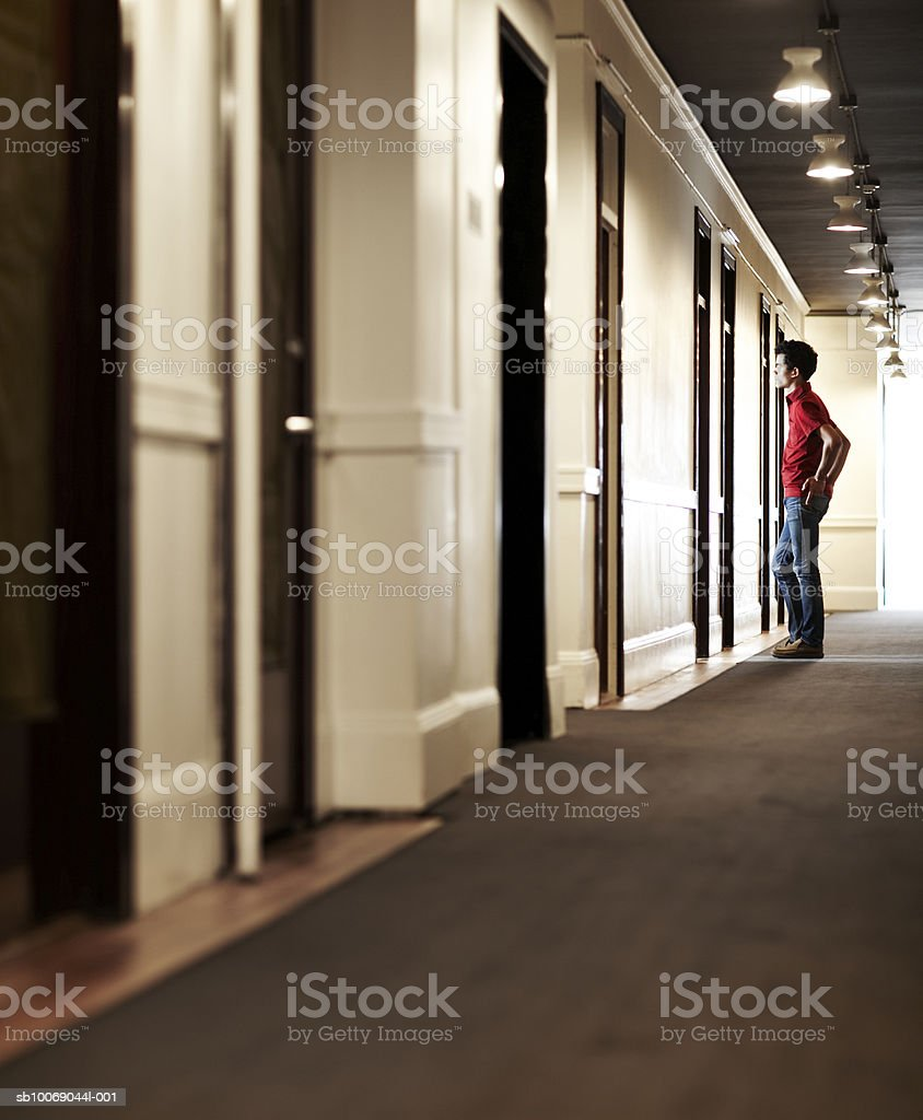 Man waiting in corridor, side view royalty-free stock photo
