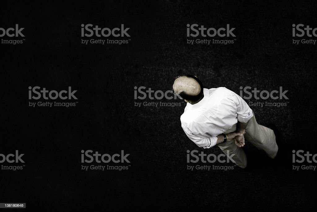 Man waiting on the middle of a road royalty-free stock photo