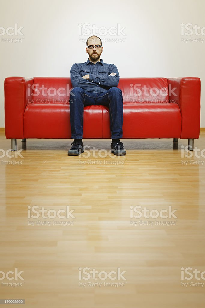 Man waiting Displeased man waiting in a sofa. 30-39 Years Stock Photo