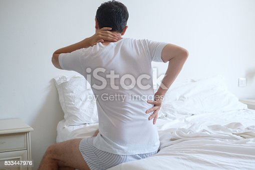 istock Man waking up in the morning and suffering because of backache 833447976