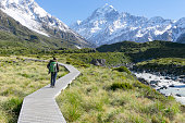 A young men enjoying the beautiful view of mt Cook , New Zealand