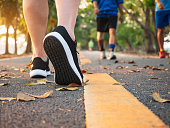 Man walk in park outdoor with People Jogging exercise Healthy lifestyle