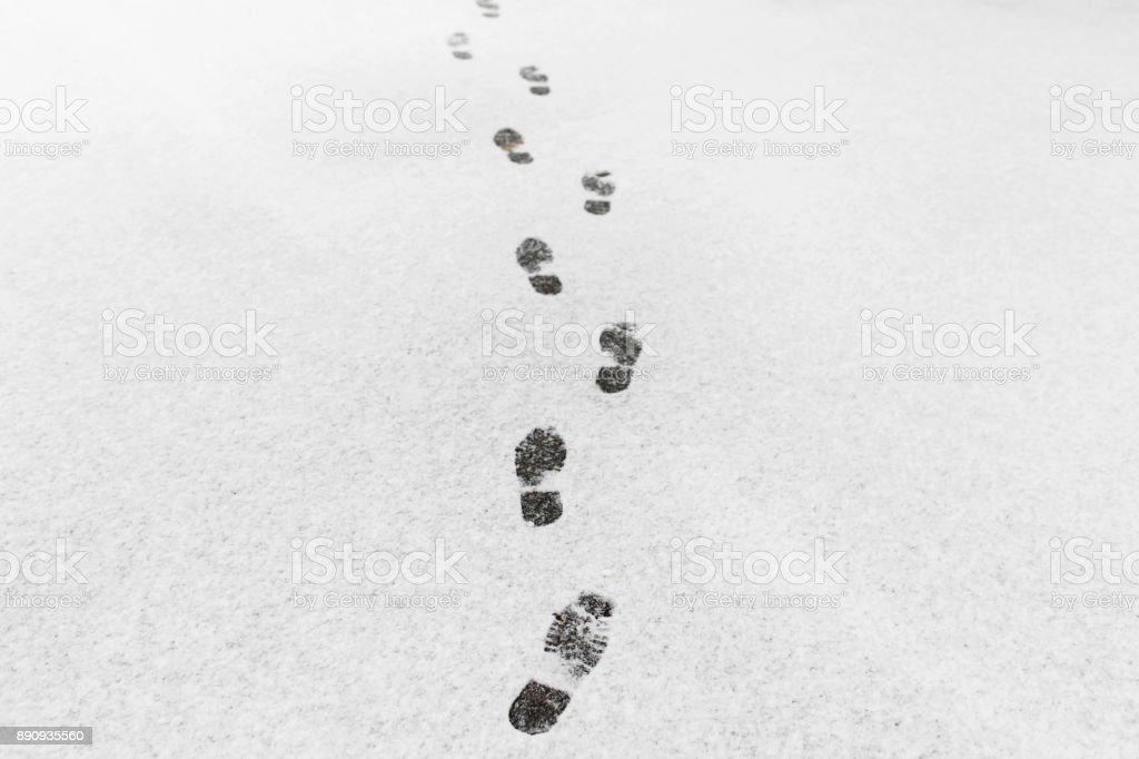 A man walked, he left footprints in the snow stock photo