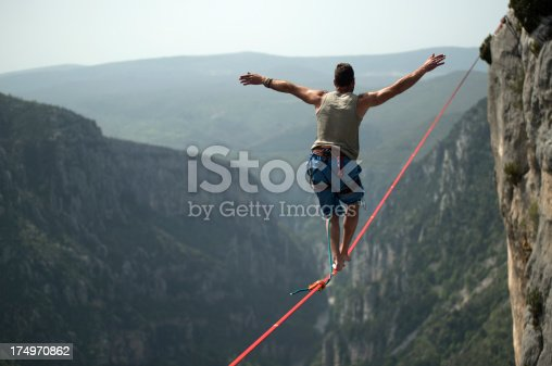 istock Man walking a slackline over Verdon Gorges, France 174970862