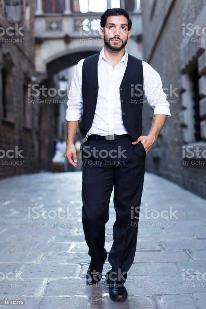 Man walking along old town street royalty-free stock photo