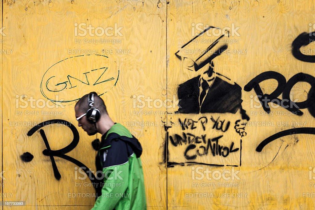 Man Walking and CCTV Camera Graffiti, Big Brother stock photo