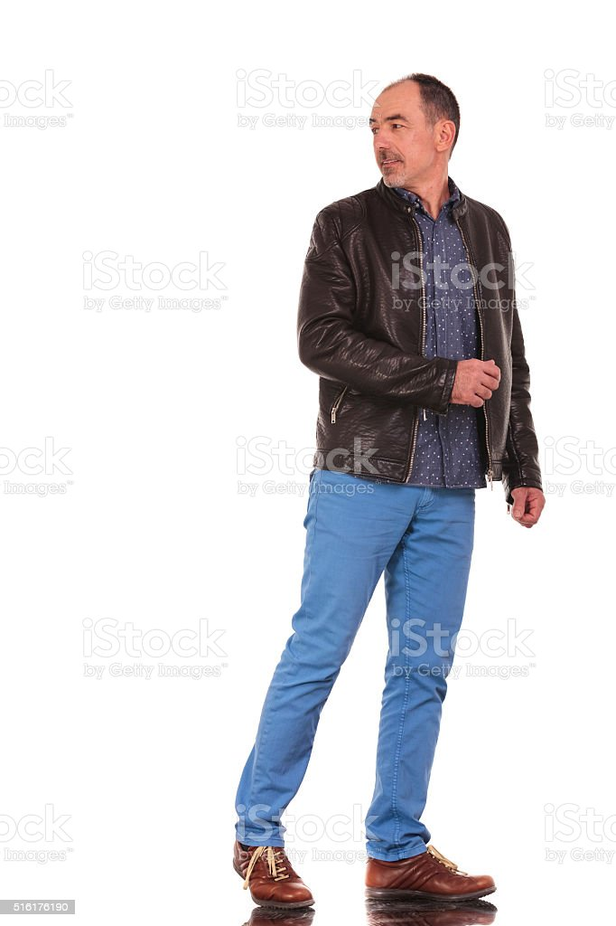 man walking and turning in isolated studio stock photo