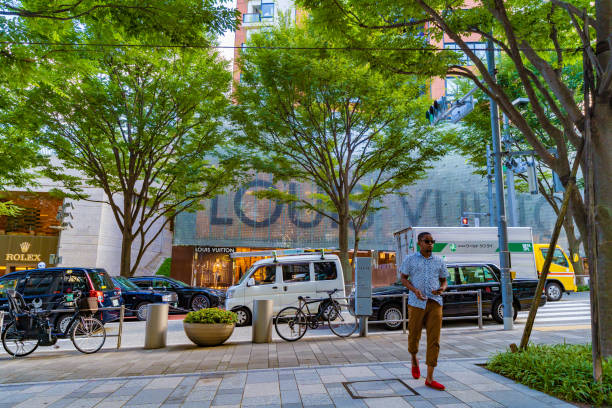 Man walking at Roppongi Hills. Tokyo Streets Cityscape. stock photo