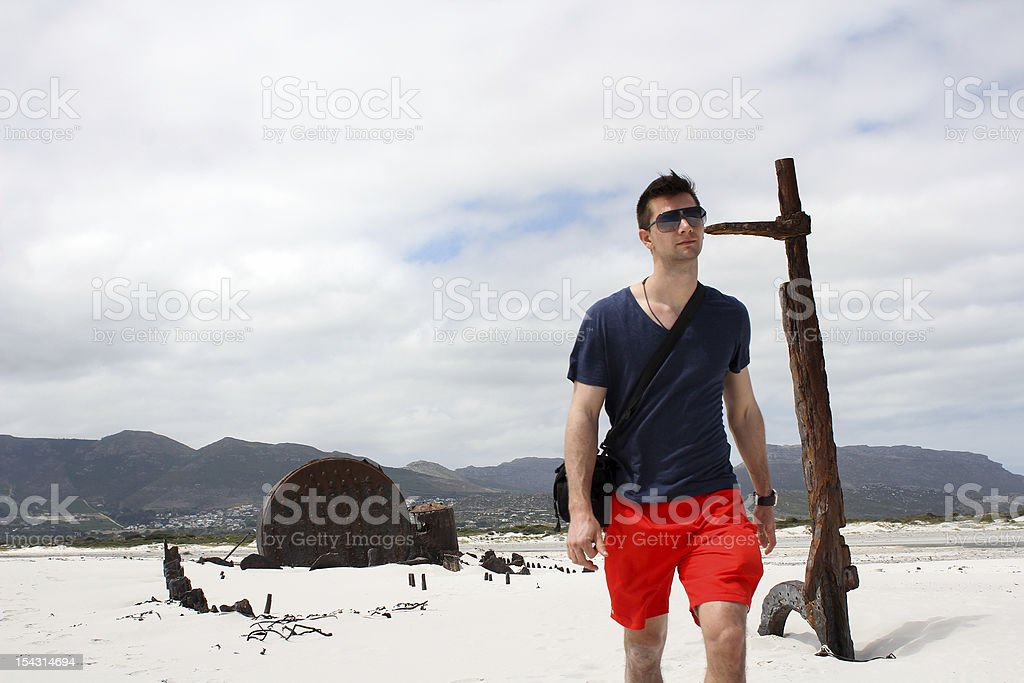 Man walking at Shipwreck Kakapo by the beach of kommetjie royalty-free stock photo