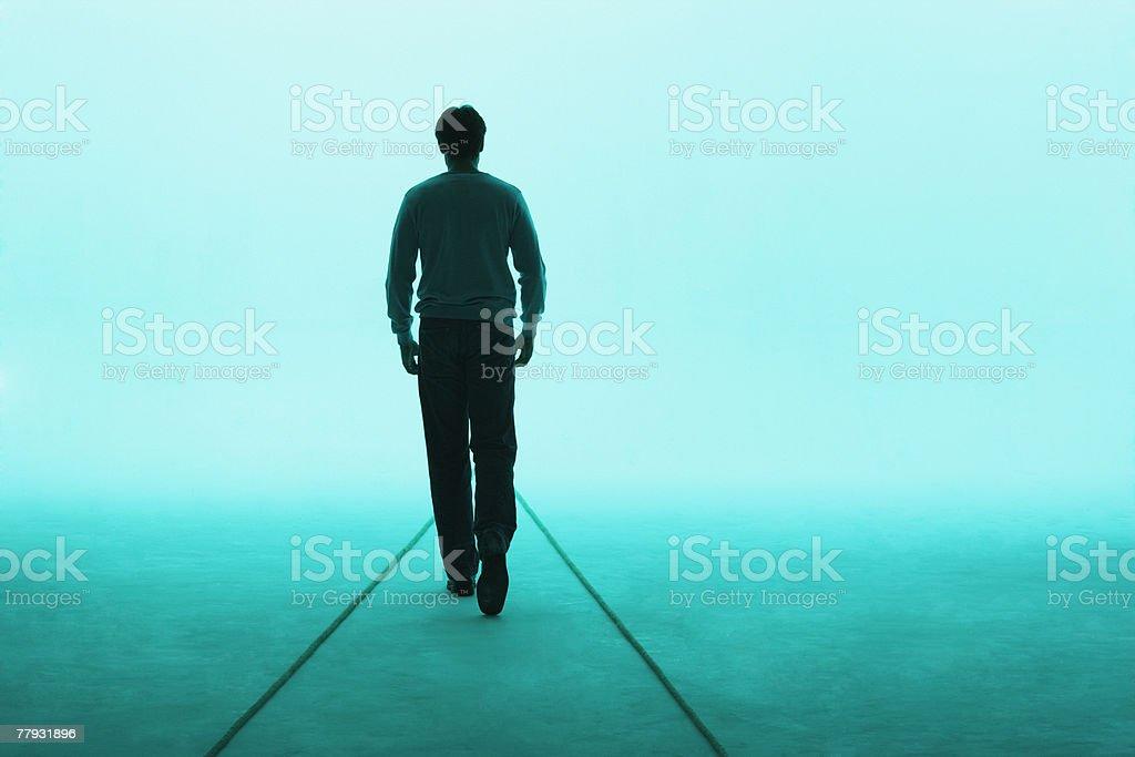 Man walking away stock photo