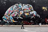 Austin, USA - March 17, 2019. A man walking by a big mural in downtown Austin, Texas, USA