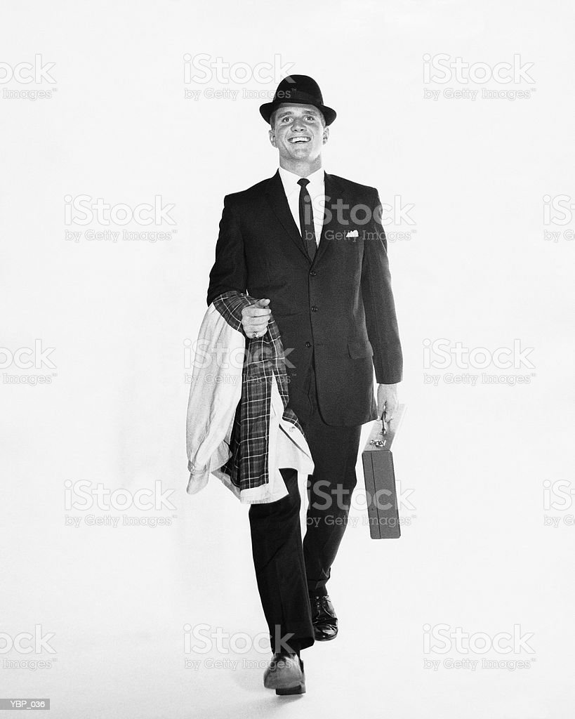 Man walking, carrying briefcase and jacket royalty free stockfoto