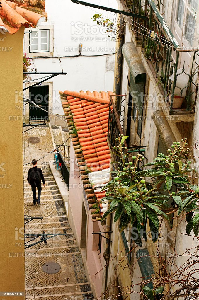 Man Walking Down Stairs in Alfama, Lisbon stock photo