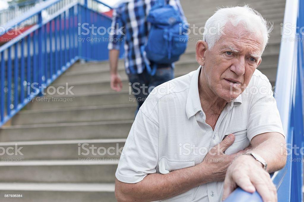 Man walking down stairs stock photo