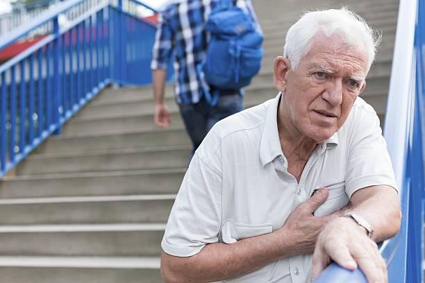 Man walking down stairs Senior weak man is walking down stairs human rib cage stock pictures, royalty-free photos & images