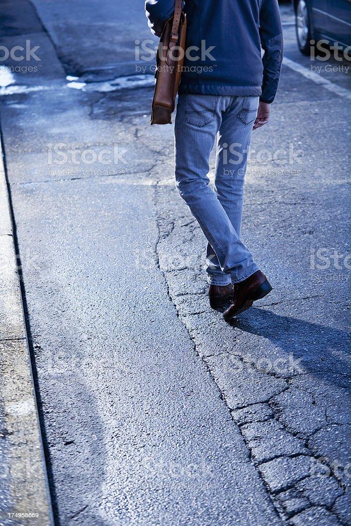 Man walking down street royalty-free stock photo