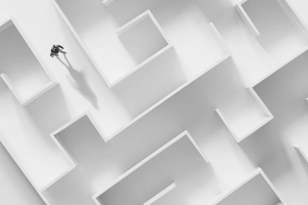 man walking in a complex maze, surreal concept stock photo