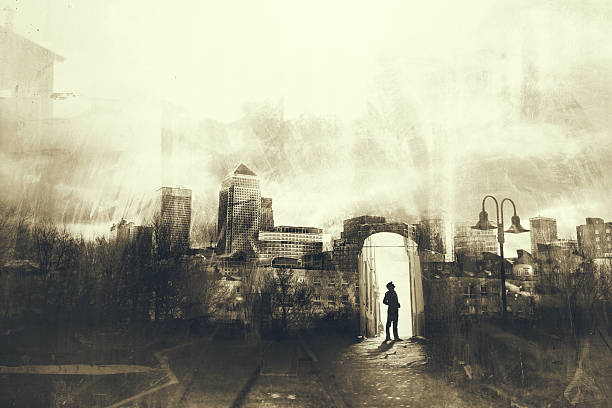 Man walking in a mystic dark city stock photo