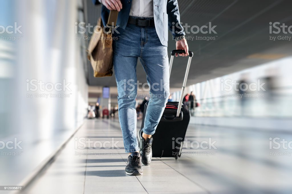 Man walking in airport stock photo