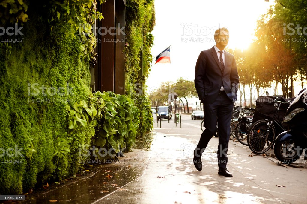 Man walking in front of vertical garden royalty-free stock photo