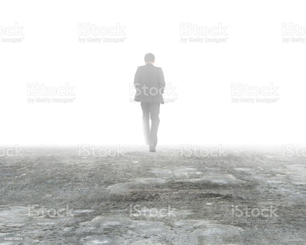 Man walking in mist on dirty concrete floor – Foto