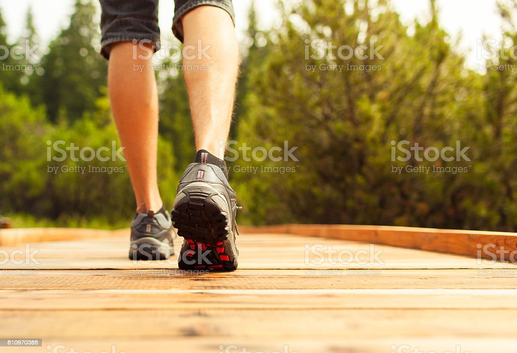 Man walking in nature stock photo