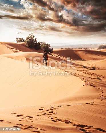 man walking in the desert