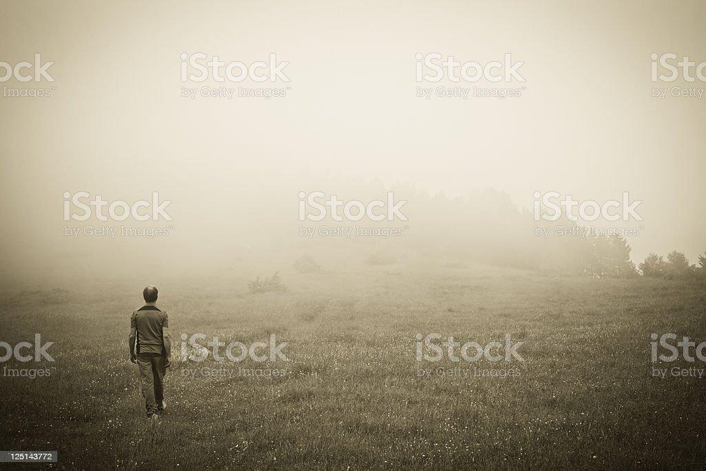 Man Walking in the Fog royalty-free stock photo