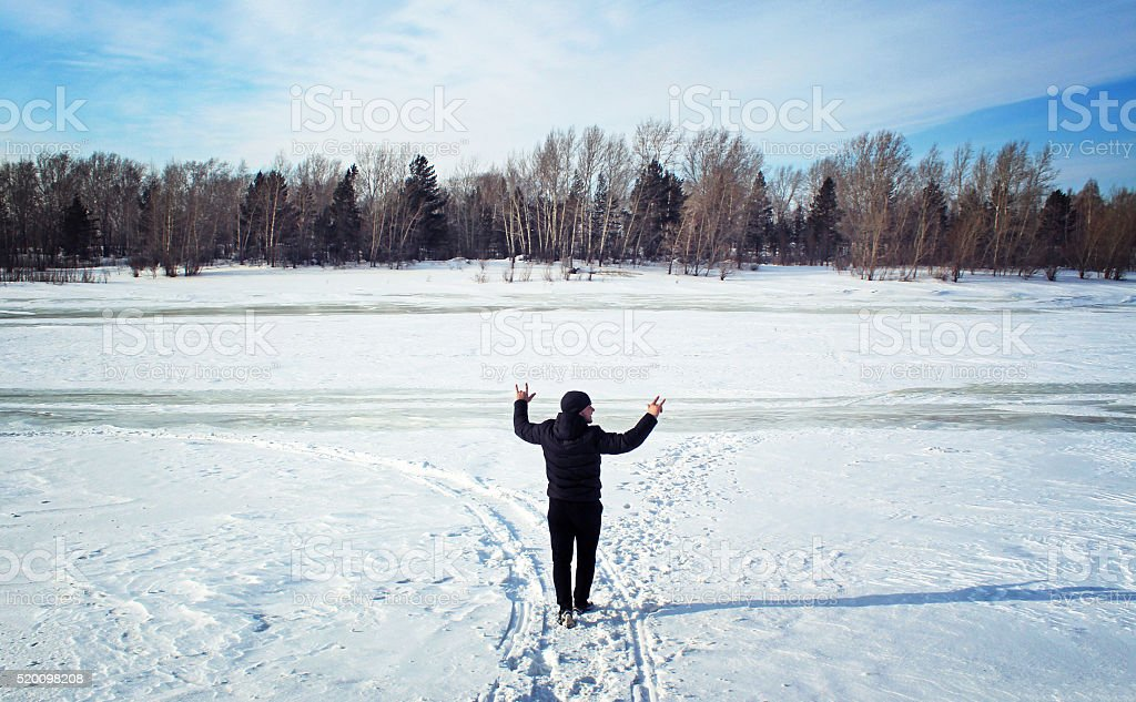Man walking in the forest in winter stock photo
