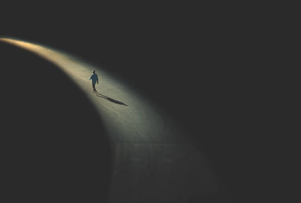 man walking in the night - one man only stock pictures, royalty-free photos & images