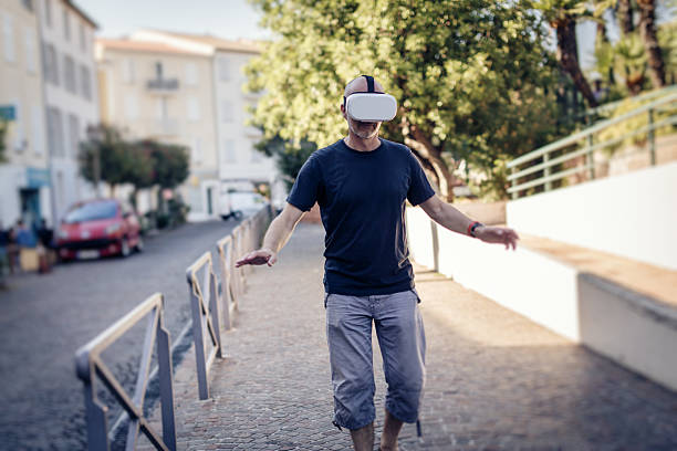 Man walking in the street wearing VR glasses stock photo