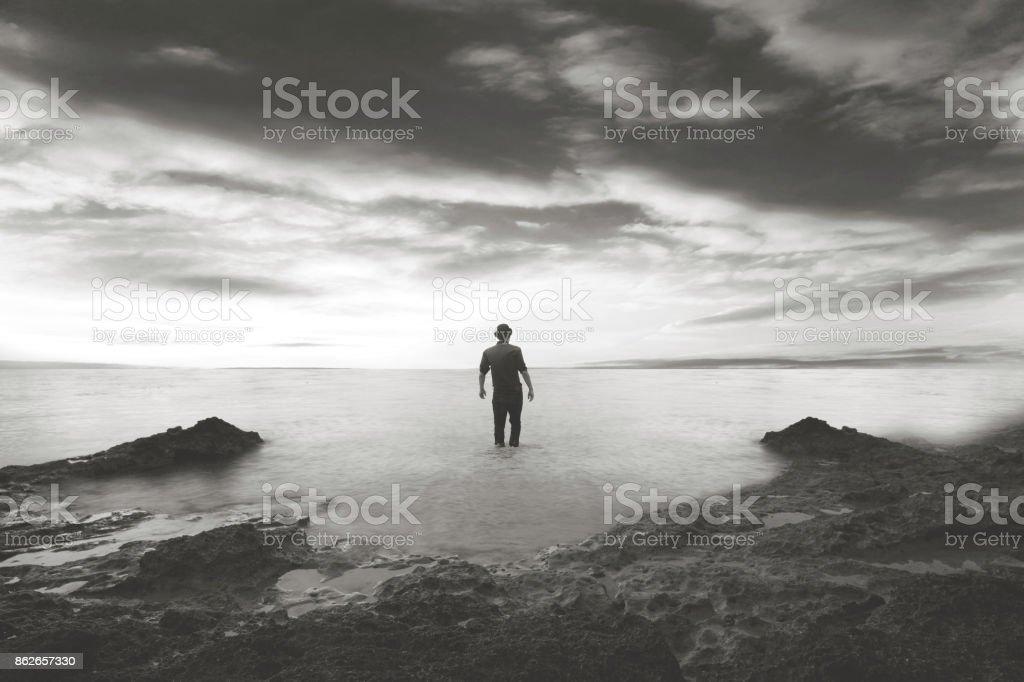 man walking in the water stock photo