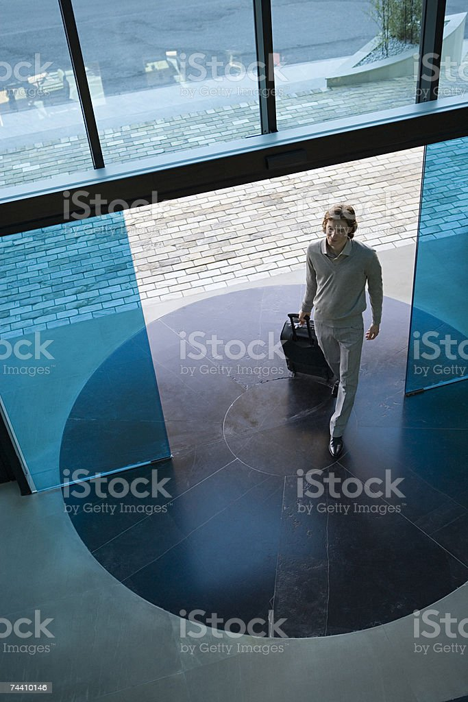 Man walking into hotel stock photo
