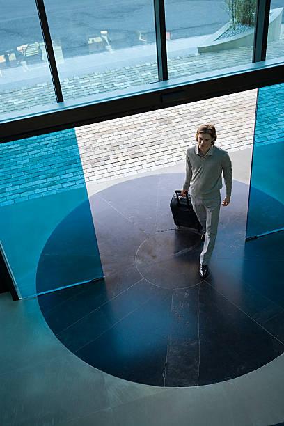 Man walking into hotel stock photo