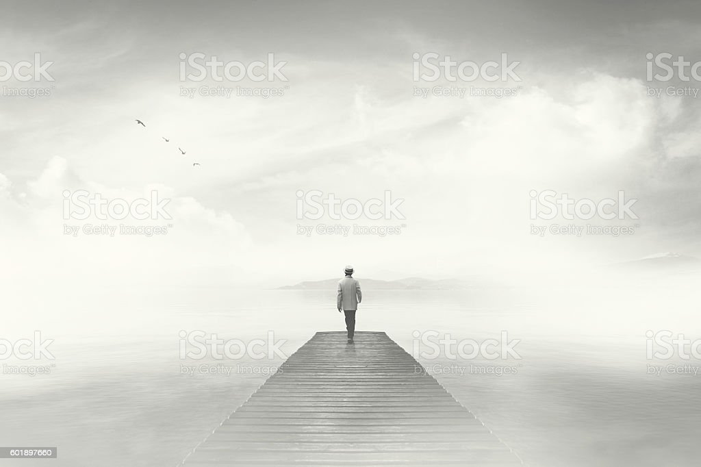 Man Walking On A Boardwalk In The Fog Stock Photo Amp More