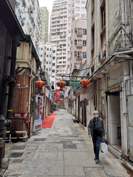 Man walking on an alley in Sai Ying Pun, Hong Kong island stock photo