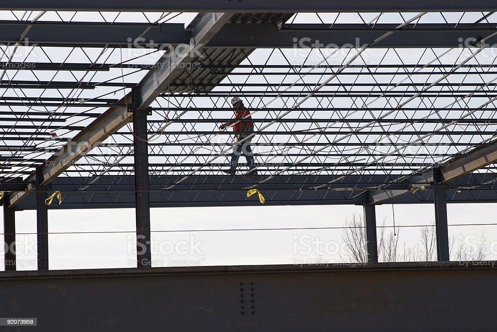 Man walking on beam royalty-free stock photo