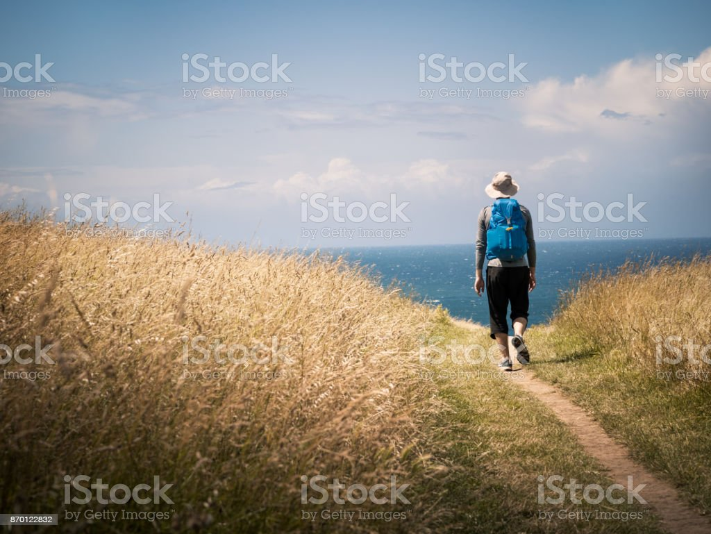 man walking on Camino de Santiago stock photo