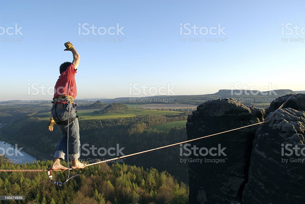 Man walking on highline above beautiful view of trees stock photo