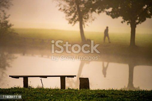 Man walking on landscape during sunset.