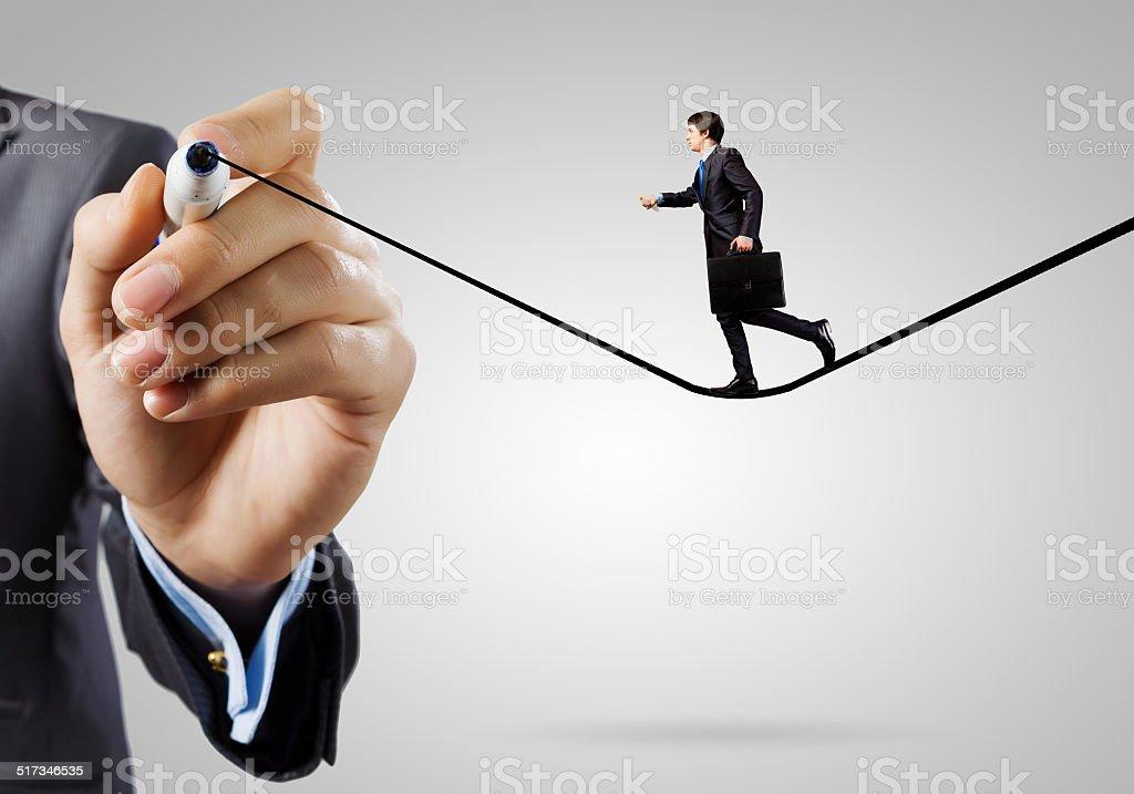 Man walking on line stock photo