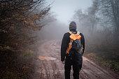 Man walking on muddy path