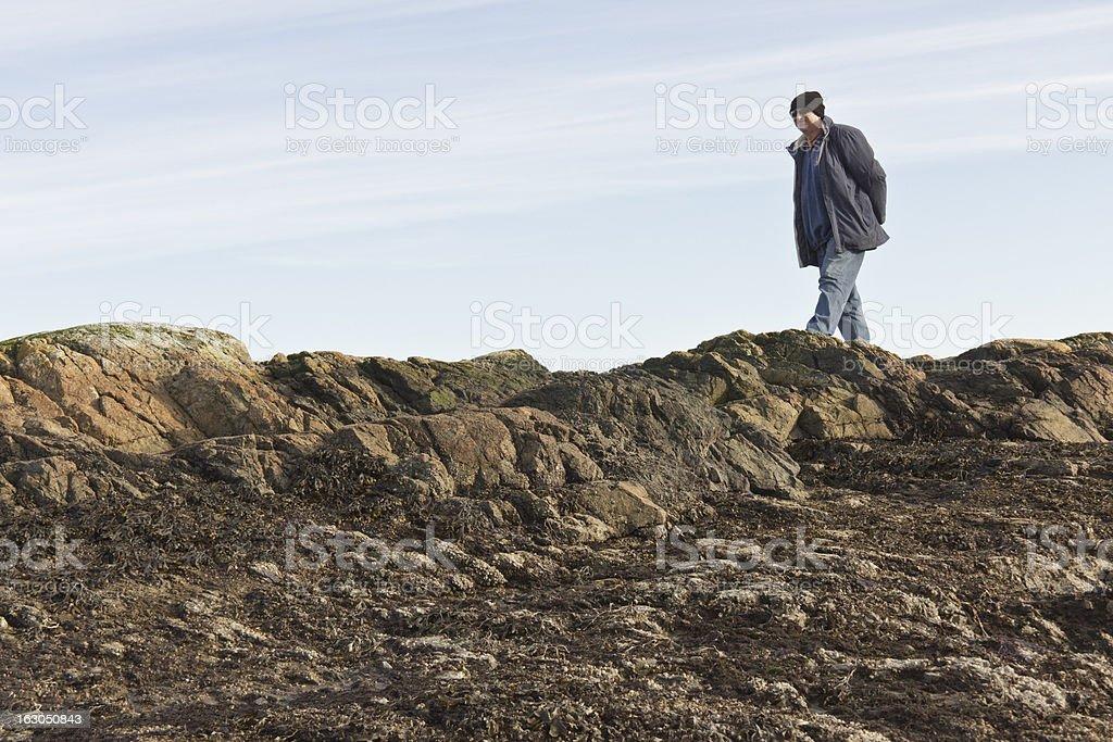 Man walking on rocks royalty-free stock photo