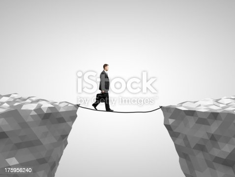 istock man walking on rope 175956240