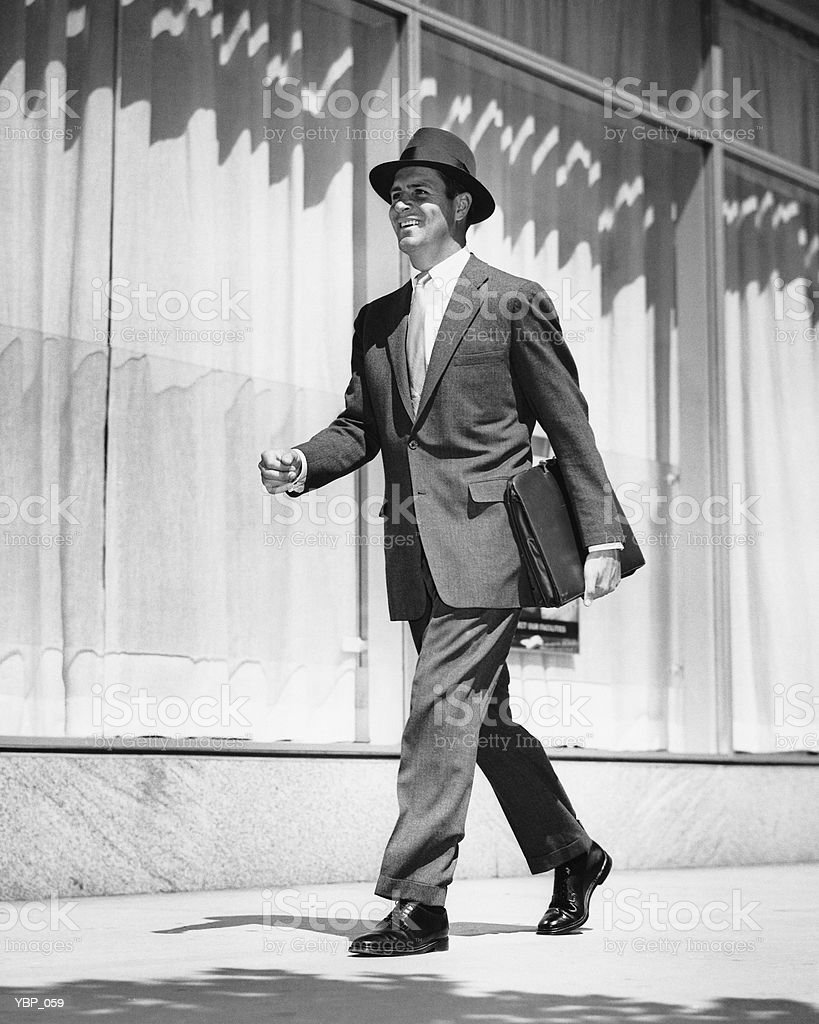 Man walking on street royalty-free stock photo