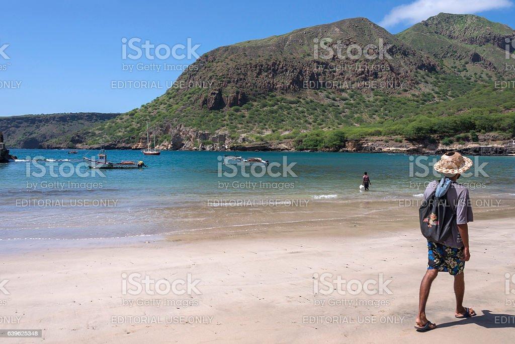 Man walking on the beach of Tarrafal - foto de stock
