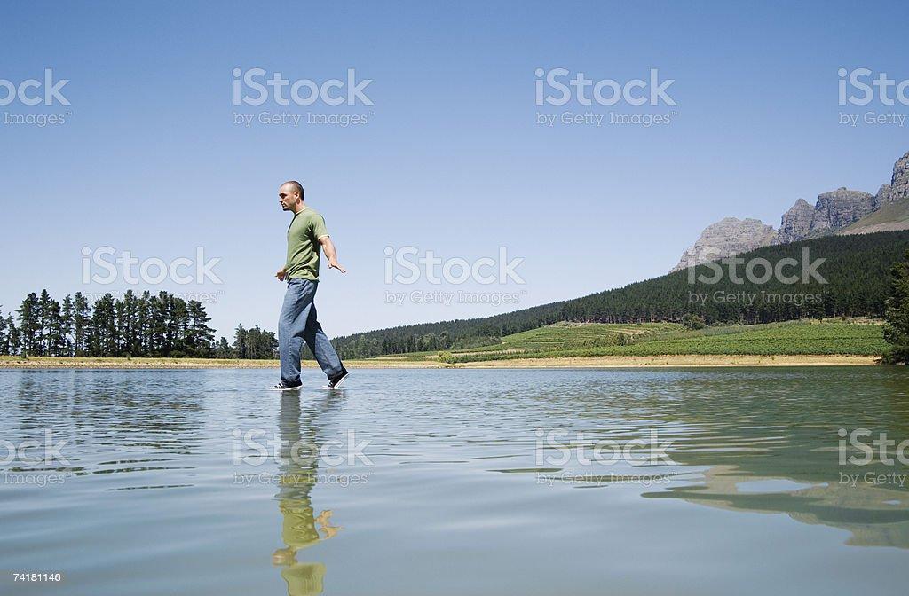 Man walking on water royalty-free stock photo
