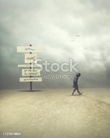 istock man walking opposite and contrary direction; surreal concept 1127074854