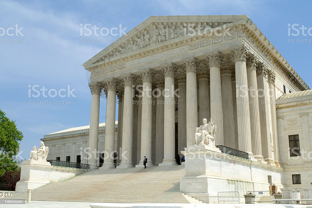 Man Walking out of the Supreme Court Building, Washington DC royalty-free stock photo
