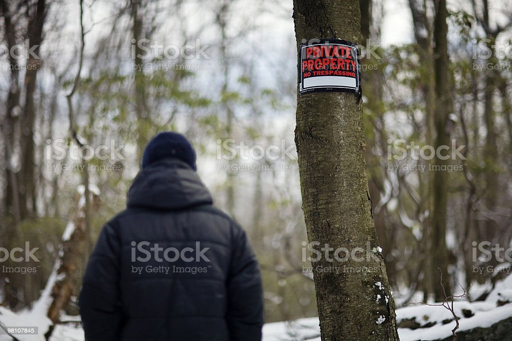 Man walking past Private Property sign. royalty-free stock photo